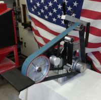 """Slick 2x72 grinder with 8"""" contact wheel and flat platten."""