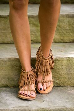905447c89cd Tan fringe thong sandals with black colored stud detail