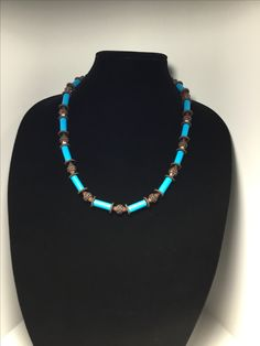 Handmade paper bead necklace accented with metal beads.