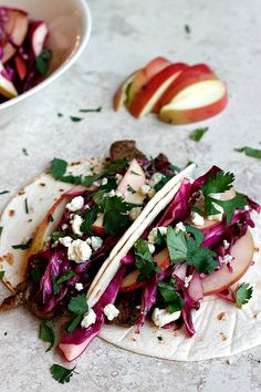 {Cider flank steak tacos with red cabbage apple slaw.}