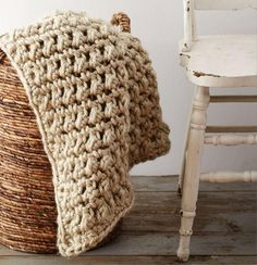 We've got a cozy fun crochet pattern for you: the Easy Going Crochet Blanket. It would be great to work up on a rainy day when you're stuck inside. This crochet afghan will be an easy project to start.