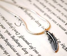 Feather Necklace by KellyStahley on Etsy, $20.00....OMG...@shayla we both need this one!!