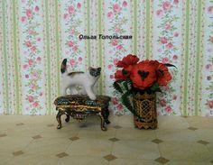 Cat. Three-colored cat. Miniature animal. Realistic cat for