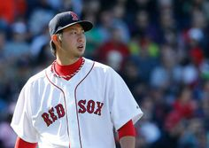BOSTON, MA - APRIL 19: Junichi Tazawa #36 of the Boston Red Sox reacts after pitching the eighth inning against the Baltimore Orioles, on the way to a 4-2 win, at Fenway Park on April 19, 2014 in Boston, Massachusetts. (Photo by Jim Rogash/Getty Images)