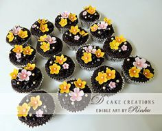 Chocolate Cupcakes decorated with sugar flowers.