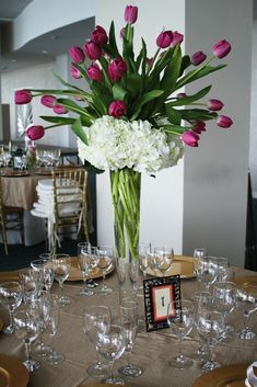 white-hydrangea-purple-tulips-Centerpieces------These are my centerpieces!!! Except purple hydrangea and yellow tulips :)
