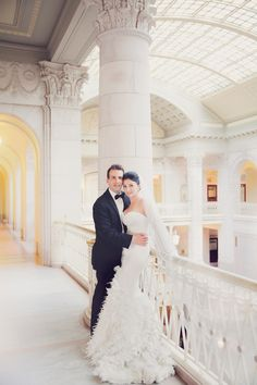 The Grecian-inspired backdrop is exquisite!  Photography by LindseyK Photography