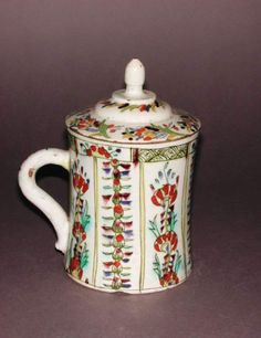Fitzwilliam Museum Collections (Id:71026)... Kütahya tankard and cover Date: circa 1700 — 1799 cylindrical with slight waisting, with a plain rim and sitting on a flat base. The cover is circular and stepped with a pointed egg-shaped central handle; the interior has a stepped lip. Dimensions: height, tankard, 12.2, cm height, cover, 6.1, cm width, whole, 14.2, cm diameter, rim, 10.1, cm diameter, rim, 10.2, cm diameter, base, 10.4, cm weight, whole, 425, g