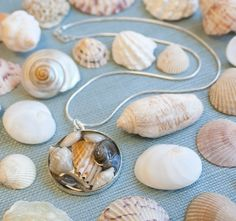 """Seashell Resin Bezel Jewelry Making """"I collaged tiny shells and bits of shells in the bezel pendant. Then I covered the shells with a layer of resin."""""""