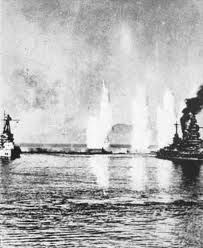 French battleships under British fire, Mers el Kebir, Algeria, July 1940.  After France's unilateral surrender the previous month a fleet led by HMS Hood destroyed these ships to prevent them being handed over to the Nazis: a significant indication of British intent to fight on without their former ally.