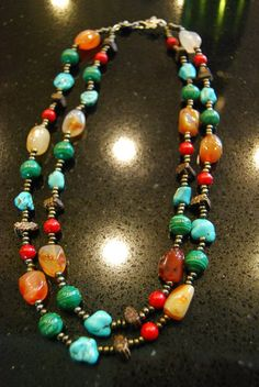 The best color combination are the ones found in nature.  This necklace has carnelian, turquoise, wood, malachite, wood, coral, seed beads, and finished w/ floral pewter hook clasp.