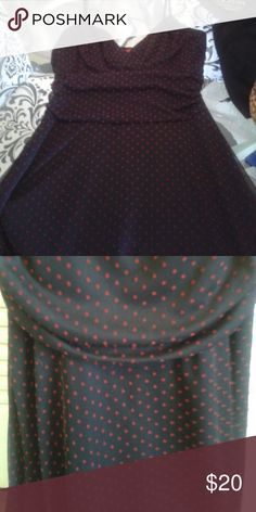 Black dress red polka dots. Feminine and flirty, fitted spaghetti strap top with flowy skirt. Dresses