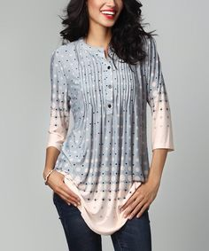 This pin tuck tunic is adorned with an artistic pattern and carefully tailored to be both flowing and flattering. Lightweight fabrication provides a breezy feel. Note: This is a one-of-a-kind item; prints may vary. Made for zulilyModel: 5' 8'' tall; 33'' bust; 24'' waist; 35'' hipsSize S: 33'' long from high point of shoulder to hem; 32'' bustTrue to sizeKnit96% rayon / 4% spandexMachine wash; hang dryImported