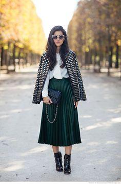 Pamela Allier street style: studded leather jacket, plissed midi skirt dark green, white collared shirt, black ankle boots