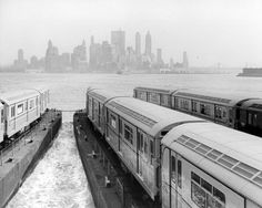 New subway cars being transported by ferry to New York City.