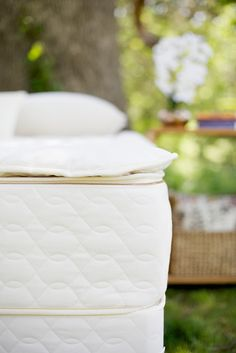 """Add plush to any mattress with this organic wool mattress topper. The Savvy Woolsy™ is a duvet-style organic cotton casing filled with 1.5"""" of fluffy organic wool fiber. The wool fill keeps the sleeping climate cool and dry and creates a uniquely comforting surface."""