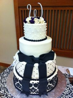 Black and White wedding cake with a touch of purple!