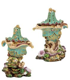 JACOB PETIT PORCELAIN ROCOCO REVIVAL FLOWER-ENCRUSTED TURQUOISE AND CLARET-GROUND POTPOURRI VASES AND COVERS.