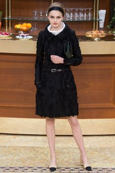 Wide neckline in a woollen city coat by Chanel Fall 2015 Ready-to-Wear Fashion Show