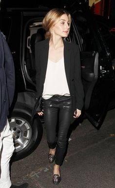 Olivia Palermo wears a camisole, blazer, coated skinny jeans, and floral flats