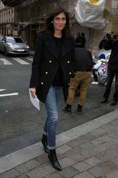 Style your jeans like Emmanuelle, and cuff your jeans to show off just the right amount of your ankle boots.