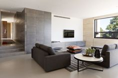 8 TV Wall Design Ideas For Your Living Room // The lack of any objects near the TV in this living space make it easy to focus on whatever is going on on the screen.