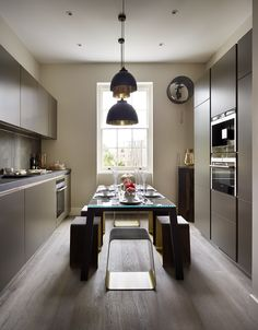 WGS, dining table and stools, glass, wood and stainless steel design Monica Armani. London apartment, project by G&T London.