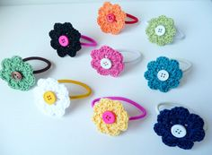 crocheted flowers on hair ties or on chained bracelets