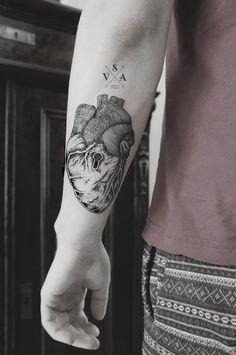 Anatomical heart with key hole tattoo
