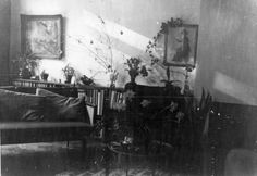 Printed black and white photograph of the sitting room of Mr and Mrs H's home on a housing estate in Highgate, London, at Christmas time. The photograph shows a coffee table that is similar to the item held in the Geffrye's collection (273/1998). The photograph was probably taken by Mr H in about 1958. This is a copy made from original photograph for the Geffrye Museum in 1996, and is one item in the Documenting Homes collection (185/2010-1 to –60) from Mr and Mrs H.