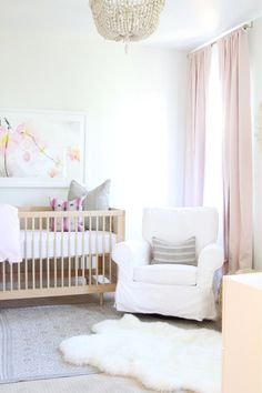 Pink and gold nursery ideas for a baby girl. Every baby's room needs a comfortable glider. Love the framed art anove the crib.