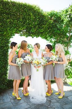 neutral dress and heels with a corresponding pop of color #bridesmaids #weddingshoes http://www.weddingchicks.com/2014/02/06/thursday-club-wedding-yellow-inspiration/