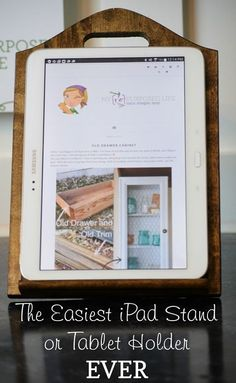 You've seen other iPad stands, but this is the easiest Oh my!  The easiest cutting board stand ever, using a picture frame back as the easel! NO woodworking sills involved, even I can do THIS! DIY iPad or tablet stand to make yourself. Personalize it to make a great gift idea.
