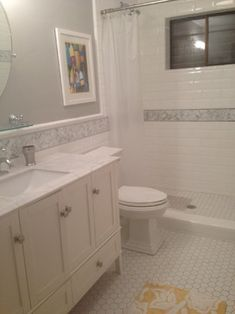 Stunning Bathroom White Bezel Edged Subway Tile Herringbone Marble Accent Tile And Hexagon