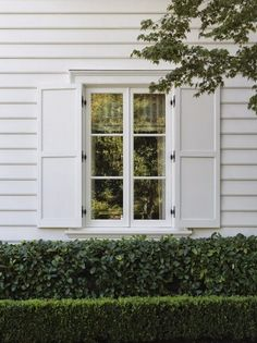 White house & shutters against two different green hedges creates interesting & subtle texture. BellaRusticaDesign.com BellaRusticaDesign.com
