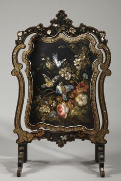 Black lacquer screen firewall  with mother-of-pearl inlay resting on four small curved feet. The swivel central panel is decorated on both faces with polychromatic bunches of flowers and...