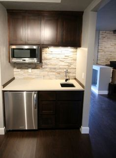 This Kitchen Is A Small Space That Is Obviously Located In A · Basement Wet  BarsBasement IdeasBasement ...