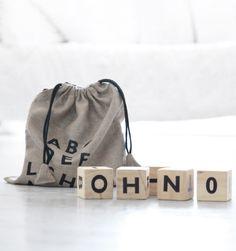Wooden alphabet blocks in a pure linen sack