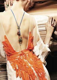 UGH backless dress with crazy orange feathers