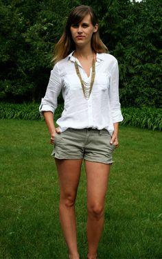 Green shorts, white linen shirt, brown belt, brown wedges, antique gold earrings.