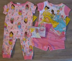 Girls will be as pretty as a princess in these pink Disney Princess Pj's. One set shorts and short sleeve shirt and other long pants with short sleeve top. Size 2T