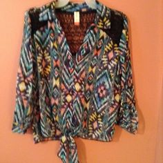 Brand new No boundaries multi colored blouse Blouse is made from 100% polyester, yet has a silky feel to it.  Comes in size large 11-13. Back panel and part of the front panel is trimmed in black lace.  The front can be tied in as shown in some of pictures.  The blouse is new and comes with an extra button. No Boundaries Tops Blouses