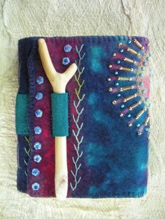 Hand-felted, resist-dyed, stitched and beaded book.