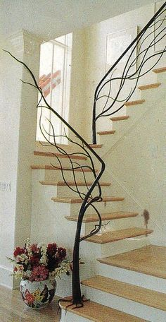 I love this custom made natural tree staircase. Staircase railing is usually just.staircase railing, but this railing is different and unique! This is great for a rustic, country, and even modern decor look. Balustrades, Banisters, Staircase Railings, Staircase Design, Modern Staircase, Hand Railing, Wrought Iron Stair Railing, Staircase Metal, Wrought Iron Decor