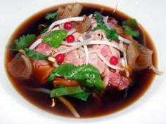 Goat pho with Shanghai noodles, bean sprout, and olive berry at Momofuku Ssam Bar, NY. (Photo by: The Food Doc)