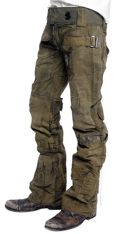 Army green CALL OF DUTY pants from JUNKER DESIGNS. Made from vintage army canvas material pieced together along with buckles and straps to make these incredible pants. Each one is made to order by hand and will vary slightly. Exposed zipper on the front adds a great look and detail.