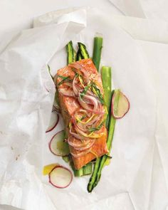 "Red onion, lemon, and tarragon come together as a tangy topping for salmon and asparagus.To make this recipe for two, as seen on ""The Martha Stewart Show,"" halve the ingredient quantities."