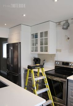 DIY: How to Disguise a Kitchen Soffit |  the perfect colour match to the IKEA white cabinets is Simply White from Benjamin Moore.