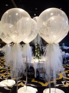 Giant 3 ft balloons wrapped in tulle. Gorgeous decoration for your wedding venue!