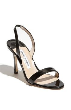 I adore the single strap over the toe look. Now, if I could find these for under $700, that would be better.